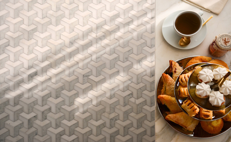 Francois Grand, a waterjet mosaic shown in honed Calacatta Tia, honed Allure, and polished Cream Onyx, is part of the Illusions® collection by New Ravenna.