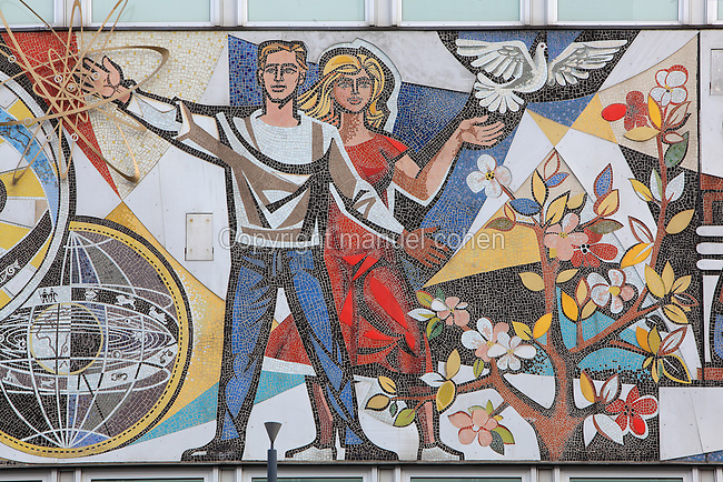 Couple with dove, from mosaic mural by Walter Womacka entitled Unser Leben or Our Life, depicting various occupations in East Berlin, on the facade of the Haus des Lehrers or House of the Teachers, built 1962-64 in East Germany or the GDR, Berlin, Germany. Picture by Manuel Cohen