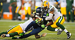 Seattle Seahawks wide receiver  Percy Harvin (11) is tackled by Green Bay Packers safety Morgan Burnett, left, and defensive backMicah Hyde (33) c in the NFL Kickoff Game game at CenturyLink Field in Seattle, Washington on September 4, 2014. Harvin caught seven passes for 59 yards, rushed for 41 and returned three kickoffs for 60 yards. The Seahawks pounded the packers 36-16. ©2014  Jim Bryant Photo. ALL RIGHTS RESERVED.