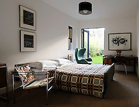 A Le Corbusier cowhide chair and a green Arne Jacobsen Egg chair are just two of the classic pieces of furniture found in this retro styled bedroom.