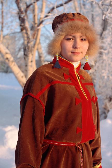 A Sami woman wearing a replica of traditional Kola Peninsula Sami dress. Sami Culture Centre, Lovozero. Murmansk, NW Russia