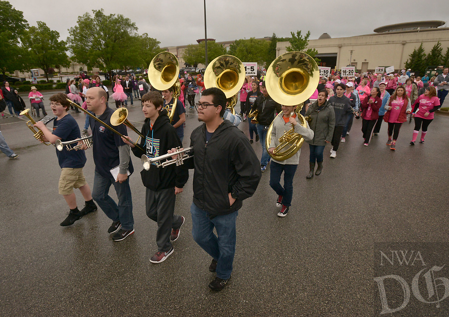 NWA Democrat-Gazette/BEN GOFF @NWABENGOFF<br /> Members of the Rogers Heritage High marching band lead the survivor parade Saturday, April 22, 2017, during the annual Susan G. Komen Ozark Race for the Cure at Pinnacle Hills Promenade in Rogers.