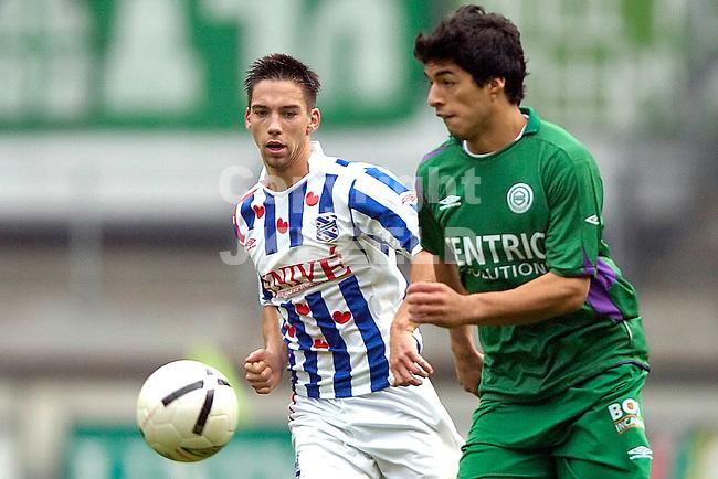 heerenveen - groningen 22-10-2006 eredivisie seizoen 2006-2007 sanchez in duel met hanssen