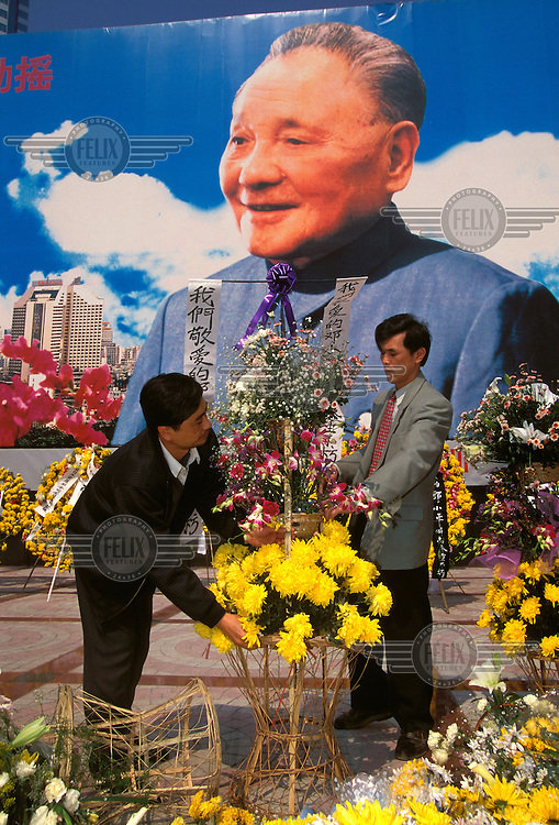 China, Guangdong, Shenhen..Propaganda poster become monument. Mourning the death of Deng Xiaoping architect of reform, in China's richest city that prospered under his patronage...Mark Henley