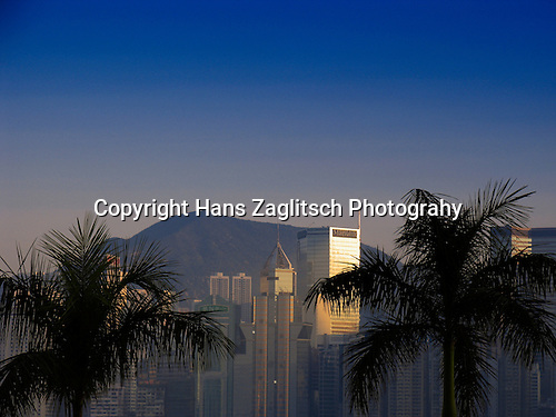 Skyline of Hongkongs Central District with Palmtrees.