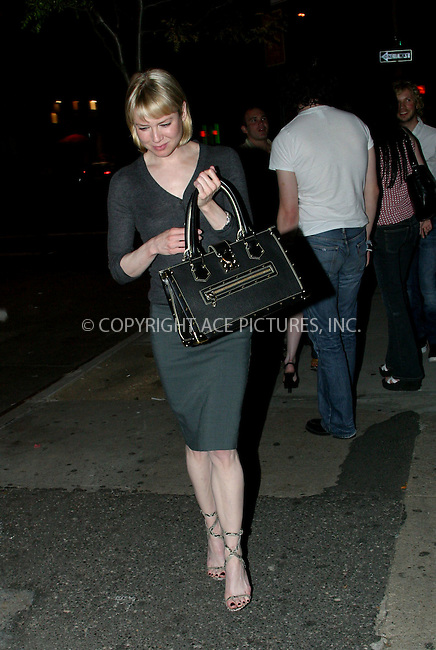 """""""Chicago"""" star Renee Zellweger was all smiles when she stepped out with her new boyfriend, 'White Stripes' frontman Jack White. The happy couple was seen leaving their Downtown hotel separately, but later, after spending about 3 hours at Fiamma Restaurant in SoHo, they walked down the street together. Jack White wore a bandage on his left arm after fracturing his index finger in a car accident on July 9 in White's hometown of Detroit. Zellweger was in the car at the time of accident but was reportedly unhurt. New York, July 25, 2003. Please byline: NY Photo Press.   ..*PAY-PER-USE*      ....NY Photo Press:  ..phone (646) 267-6913;   ..e-mail: info@nyphotopress.com"""