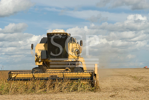 Mato Grosso State, Brazil. Soya being harvested  where forests stood only a few years ago.