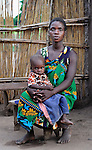 "Alidia Jospehine holds her 2-year old son Yohani in Dickson, a village in southern Malawi that has been hard hit by drought in recent years, leading to chronic food insecurity, especially during the ""hunger season,"" when farmers are waiting for the harvest. In addition to providing emergency food, the ACT Alliance is working with farmers in this village to switch to alternative, drought-resistant crops, as well as installing an irrigation system and utilizing other improved techniques to increase agricultural yields. Josephine's son was severely malnourished, but with help from the ACT Alliance is recovering good health."