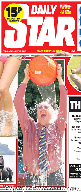Published photo in the Daily Star, showing how one businessman chooses to cool off during an exceptionally warm heatwave.<br /> <br /> <br /> Pic: Chris Balcombe<br /> 07568 098176