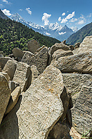 Mani stones with Kusum Kangkaru in the background, Khumbu, Nepal