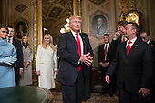 United States President Donald Trump leaves the President's Room of the Senate on Capitol Hill in Washington, Friday, Jan. 20, 2107, after he formally signed his cabinet nominations into law. He is joined at far left by his wife, first lady Melania Trump and daughter Tiffany Trump. At far right is Chief of Staff Reince Priebus, with White House counsel Donald McGahn, second from right. <br /> Credit: J. Scott Applewhite / Pool via CNP