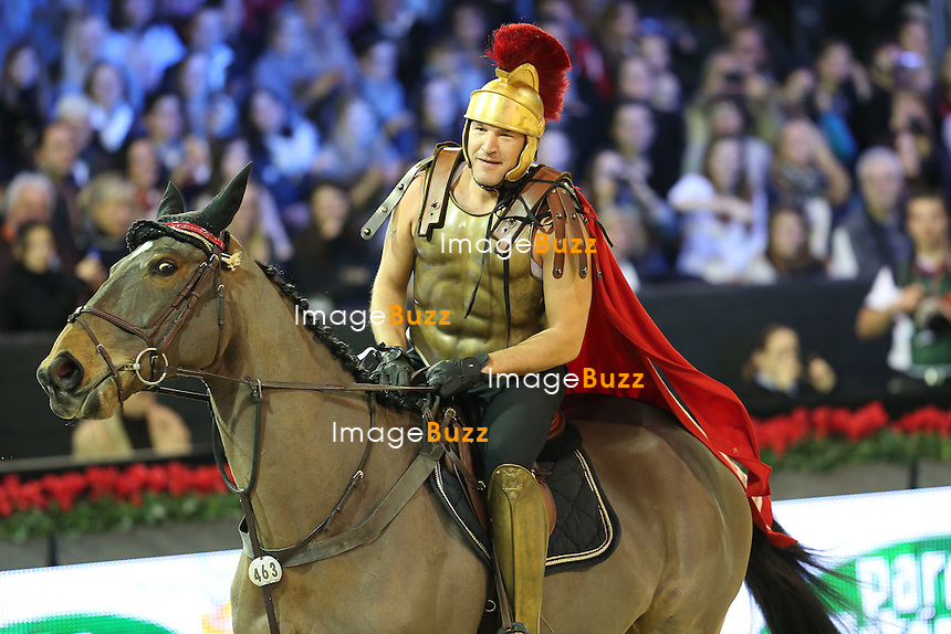 CPE/Benjamin Castaldi (wearing centurion roman army dress) rides Noxen Mouche during the Style & Competition for Amade at the Gucci Paris Masters 2012 at Paris Nord Villepinte on December 1, 2012 in Paris, France.