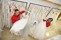 "Pictured: Staff members, Jonathan Beasley and Jo Williams pictured amongst the wedding dresses on offer at John Pye Auctions in Pyle, south Wales, UK.<br /> Re: A bride cried tears of joy after her missing wedding dress was found among a pile of 20,000 gowns in a warehouse.<br /> Meg Stamp, 27, paid £1,300 for the beautiful ivory lace dress but it  was seized by liquidators after a bridal company went bust.<br /> It was boxed up along with 20,000 others and due to be sold for a knock-down price at auction.<br /> But determined Meg banged on the auctioneer door saying: ""I want my dress back"".<br /> Staff at John Pye auctioneers in Port Talbot spent three hours sifting through boxes until they finally found Meg's dream dress."