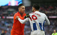 Manchester City's Ederson pulls Brighton & Hove Albion's Alireza Jahanbakhsh away from Kyle Walker<br /> <br /> Photographer Rob Newell/CameraSport<br /> <br /> Emirates FA Cup Semi-Final - Manchester City v Brighton & Hove Allbion - Saturday 6th April 2019 - Wembley Stadium - London<br />  <br /> World Copyright © 2019 CameraSport. All rights reserved. 43 Linden Ave. Countesthorpe. Leicester. England. LE8 5PG - Tel: +44 (0) 116 277 4147 - admin@camerasport.com - www.camerasport.com