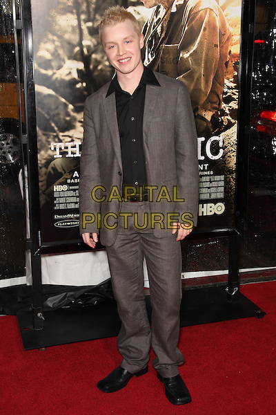 NOEL FISHER.Arrivals to the Los Angeles Premiere of the HBO Miniseries The Pacific at Grauman's Chinese Theatre, Hollywood, CA, USA, February 24th, 2010. .full length brown grey gray suit black shirt .CAP/CEL.©CelPh/Capital Pictures.