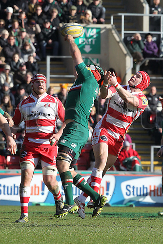 16.02.2014 Leicester, England. Leicesters Julian Salvi and Gloucesters Rob Cook jump to catch the high-ball during the Aviva Premiership game between Leicester Tigers and Gloucester Rugby from Welford Road Stadium.