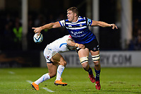 Tom Ellis of Bath Rugby offloads the ball after being tackled by Santiago Cordero of Exeter Chiefs. Gallagher Premiership match, between Bath Rugby and Exeter Chiefs on October 5, 2018 at the Recreation Ground in Bath, England. Photo by: Patrick Khachfe / Onside Images