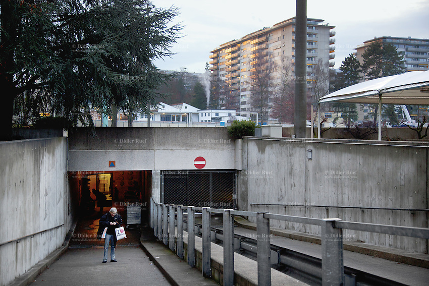 Switzerland. Geneva. A group of homeless people, both men and women, leave the fallout shelter Richemont in the early morning. The bunker was constructed as civil defense measures during the Cold War and is a unit of the Civil Protection. Switzerland is unique in having enough nuclear fallout shelters to accommodate its entire population. 8.02.2014 © 2014 Didier Ruef