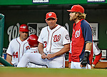 17 May 2012: Washington Nationals outfielder Jayson Werth (right) chats with Bench Coach Randy Knorr during a game against the Pittsburgh Pirates at Nationals Park in Washington, DC. Werth is recovering from a left distal radius fracture. The Pirates defeated the Nationals 5-3 in the second game of their 2-game series. Mandatory Credit: Ed Wolfstein Photo