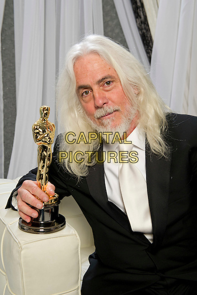 "Oscar®-winning cinematographer Robert Richardson, winner for Achievement in Cinematography for work done on ""Hugo"", poses backstage during the live ABC Television Network broadcast of the 84th Annual Academy Awards® from the Hollywood and Highland Center, in Hollywood, CA, Sunday, February 26, 2012..*Editorial Use Only*.oscars award trophy winner half length black suit beard facial hair .CAP/A.M.P.A.S./NFS.©A.M.P.A.S. Supplied by Capital Pictures."