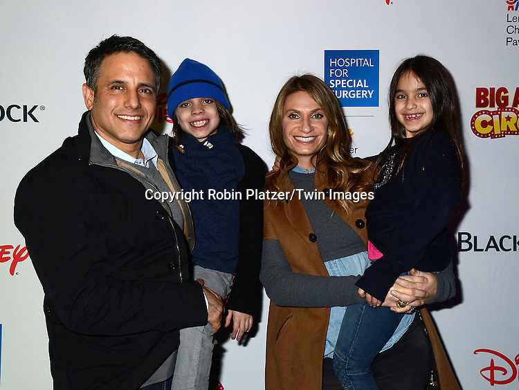 Heather Thomson and Jax and Ella and husband Jon Schindler attend the Hospital for Special Surgery's 8th Annual  Big Apple Circus Benefit on December 6, 2014 at Damrosch Park in Lincoln Center  in New York City, USA.<br /> <br /> photo by Robin Platzer/Twin Images<br />  <br /> phone number 212-935-0770
