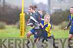 Aishling O'Hagan of Thurles gats tackled by Jyne Pennyfather of Carrigaline at the Girls Munster Rugby blitz last Saturday afternoon in The Grove, Abbeyfeale.