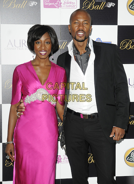 BEVERLEY KNIGHT & guest.Attending The Grand Prix Ball at The Hurlingham Club, London, England, .UK, 7th July 2010. .half length bright pink dress   silver beaded white shirt black suit jacket grey gray tie scarf .CAP/CAN.©Can Nguyen/Capital Pictures.
