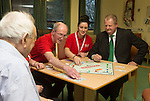 Keith Farron from TATA Steel with volunteers from Age Cymru Glyn Thomas &amp; Sophie Wilson at St Woolos Hospital in Newport.<br /> <br /> 05.12.13<br /> &copy;Steve Pope-FOTOWALES