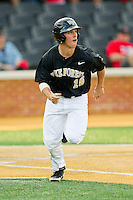 Andrew Williams (16) of the Wake Forest Demon Deacons hustles down the first base line against the North Carolina State Wolfpack at Wake Forest Baseball Park on March 16, 2013 in Winston-Salem, North Carolina.  The Demon Deacons defeated the Wolfpack 13-4.  (Brian Westerholt/Four Seam Images)