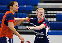 06 APR 2012 - LONDON, GBR - Yvonne Leuthold (left) and Lynn McCafferty (right) joke during a Great Britain women's handball team training session  (PHOTO (C) 2012 NIGEL FARROW)