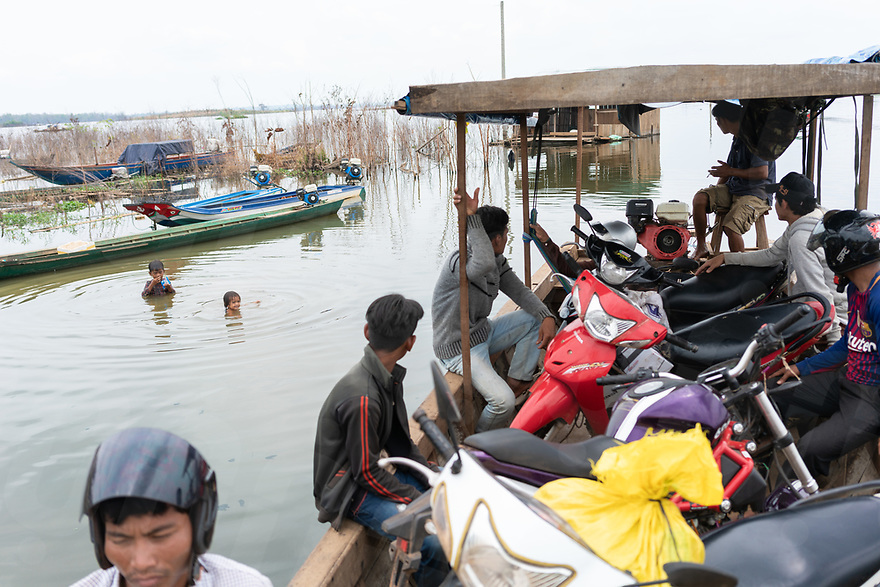 April 27, 2018 - Stung Treng (Cambodia). A ferry's service now help connecting the 2 shores of the Lower Sesan 2 dam's reservoir transporting goods and people. With the closing of the dam's gates, the villages of Kbal Romeas and nearby Srekor were flooded and a massive lake now covers what once were hectares of ancestral forests and rice fields and dozen of families of fishermen have moved from other Cambodian provinces to take advantage of the abundance of fish. © Thomas Cristofoletti / Ruom