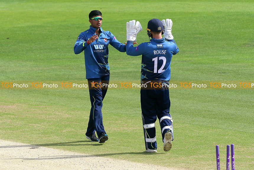 Imran Qayyum (L) of Kent celebrates taking the wicket of Varun Chopra during Kent Spitfires vs Essex Eagles, Royal London One-Day Cup Cricket at the St Lawrence Ground on 17th May 2017