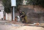 An Israeli soldier takes position during clashes with Palestinian protesters next to the Jewish settlement of Psagot, near the West Bank city of Ramallah, November 3, 2015. The current wave of violence erupted in mid-September, fueled by rumors that Israel was trying to increase Jewish presence in Jerusalem then quickly spread across Israel, the West Bank and the Gaza Strip. Photo by Shadi Hatem