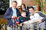 Aidan O'Mahony who presented his football boots to an anonymous kid in the crowd who captured his heart with his smile after the All Ireland final met up with  Diarmuid de Bhillis and his dad Dick at Home from Home Fossa on Thursday where he brought the Sam Maguire also in picture is Helena Fox manager