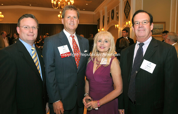 SOUTHINGTON, CT-17 SEPTEMBER 2009-091709JS18-Patrick Hayden and Garth Collins, left, both members of the Waterbury Regional Chamber's Board of Directors, with Claudia Hughes and Robert Hughes of Eyelet Design Inc,, at the 15th annual Waterbury Regional Chamber's Malcolm Baldrige Volunteer Awards dinner Thursday at the Aqua Turf Club in Southington.<br /> Jim Shannon Republican-American