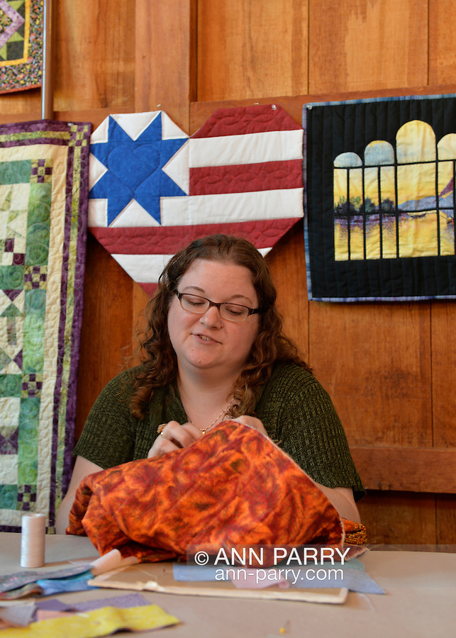 Old Bethpage, New York, U.S. 29th September 2013.  LAURA BORLEY, of Jericho, a Long Island Quilters' Society member, is quilting in the Exhibition Hall at The Long Island Fair. A yearly event since 1842, the county fair is now held at a reconstructed fairground at Old Bethpage Village Restoration.