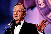 United States President George H.W. Bush makes remarks at an Inaugural Ball on Inauguration Day, January 20, 1989 in Washington, DC.<br /> Credit: Pam Price / Pool via CNP