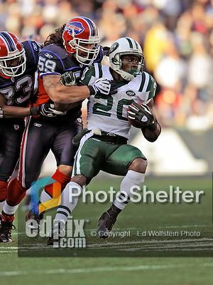 2 November 2008:  New York Jets' running back Thomas Jones (20) is tackled by Buffalo Bills linebacker Kawika Mitchell (59) at Ralph Wilson Stadium in Orchard Park, NY. The Jets defeated the Bills 26-17 improving their record to 5 and 3 for the season...Mandatory Photo Credit: Ed Wolfstein Photo