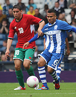Men's Olympic Football match Honduras v Morocco on 26.7.12...Abdelaziz Barrada of Morocco challenges with Arnold Peralta of Honduras, during the Honduras v Morocco Men's Olympic Football match at Hampden Park, Glasgow...........