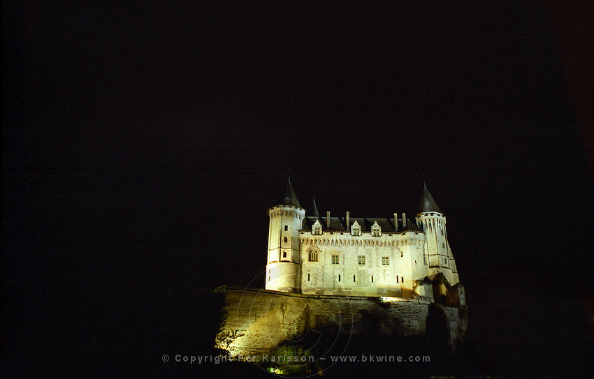 The Chateau de Saumur seen from below at night, once inhabited by Anne d'Anjou, Maine et Loire, France