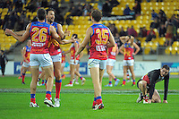 Lions players celebrate at the final whistle during the ANZAC Day AFL match between St Kilda Saints and Brisbane Lions at Westpac Stadium, Wellington, New Zealand on Friday, 25 April 2014. Photo: Dave Lintott / lintottphoto.co.nz