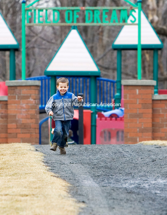PROSPECT, CT- 13 MARCH 07- 031307JT01- <br /> Brendan Healy, 3, of Waterbury, runs down the path coming from the playground at Hotchkiss Park in Prospect on Tuesday.<br /> Josalee Thrift Republican-American