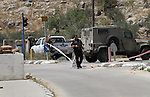 Israeli security forces inspect the scene of a stabbing attack at a checkpoint near the West Bank city of Tulkarem on June 2, 2016. A female Palestinian tried to stab an Israeli soldier near of Tulkarem and was shot dead, the army said, the latest in a series of such incidents since October. Photo by Nedal Eshtayah