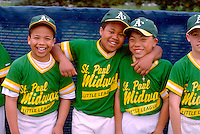 Teammates age 12 on an inner city little league baseball team at Dunning Field.  St Paul  Minnesota USA