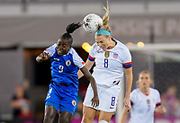 HOUSTON, TX - JANUARY 28: Julie Ertz #8 of the United States and Sherly Jeudy #9 of Haiti head battle in the air for a ball during a game between Haiti and USWNT at BBVA Stadium on January 28, 2020 in Houston, Texas.