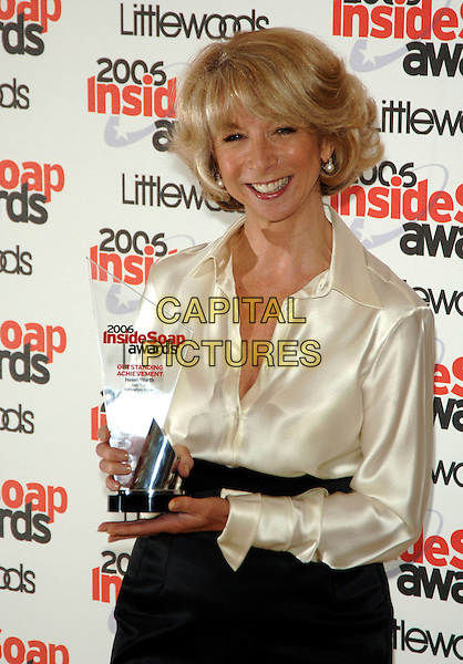 HELEN WORTH.Inside Soap Awards 2006, Floridita,.London, England, September 25th 2006..half length winner award trophy cream satin shirt blouse white.Ref: PL.www.capitalpictures.com.sales@capitalpictures.com.©Phil Loftus/Capital Pictures