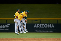 AZL Athletics Gold outfielders Marcus Smith (5), Shane Selman (13), and Rafael Rincones (8) celebrate a victory after an Arizona League game against the AZL Cubs 1 at Sloan Park on June 20, 2019 in Mesa, Arizona. AZL Athletics Gold defeated AZL Cubs 1 21-3. (Zachary Lucy/Four Seam Images)