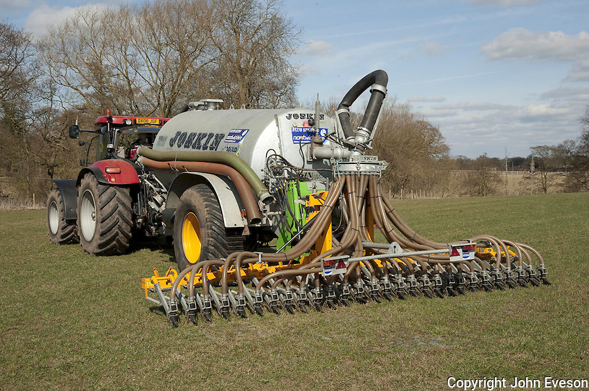 Joskin slurry tanker and slurry injector injecting slurry into grassland, Cheshire.