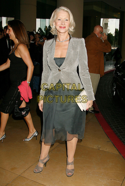 HELEN MIRREN.79th Annual Academy Awards Nominees Luncheon held at the Beverly Hilton Hotel, Beverly Hills, California, USA..February 5th, 2007.full length grey gray jacket skirt white clutch purse .CAP/ADM/RE.©Russ Elliot/AdMedia/Capital Pictures
