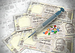 Paper currency with medicines and syringe on chart representing investment in stock market